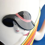 raised decoration of Art Deco lady with black hat and red lipstick