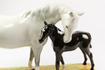 White grey mare and black foal showing ears of beswick 1811