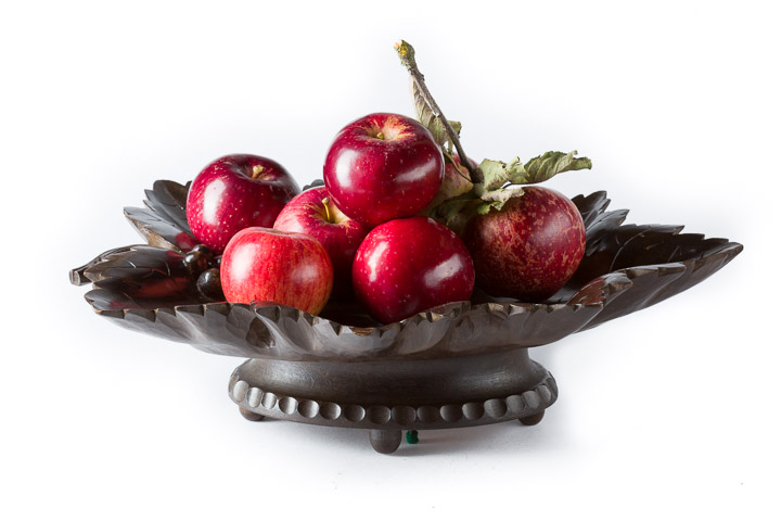 Black Forest Musical Fruit Bowl filled with red apples carved as a vine leaf from beechwood