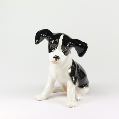 Slyvac Ceramic Pottery Figurine of Small Black and White Spaniel Puppy, model 2974 in gloss glaze