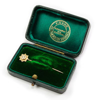 Antique gold tie stick pin with diamond chip and chester gold hallmark in green velvet presentation case by jeweller X.Ganz of 231 High Street, Swansea