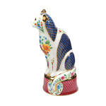 side view of white porcelain cat candle snuffer showing deep blue panels of a Worcester 'scale' pattern