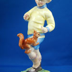 close up of red squirrel on boys leg, porcelain figure