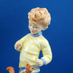 view towards hand painted head of F.G Doughty modelled royal worcester china figurine