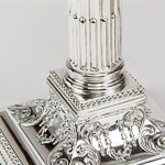 Silver corinthiam reeded and fluted fluted columns, beeded borders and hand-chased square bases with floral decoration