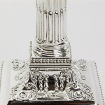 James Dixons candlesticks with embossed scrolling leaf and husk swag decoration amidst two bands of bead ornamentation