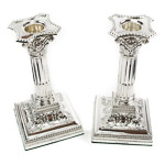 Neoclassical Corinthian column silver candlesticks, stepped square bases and a band of embossed bead decoration to the rim of detachable scounce